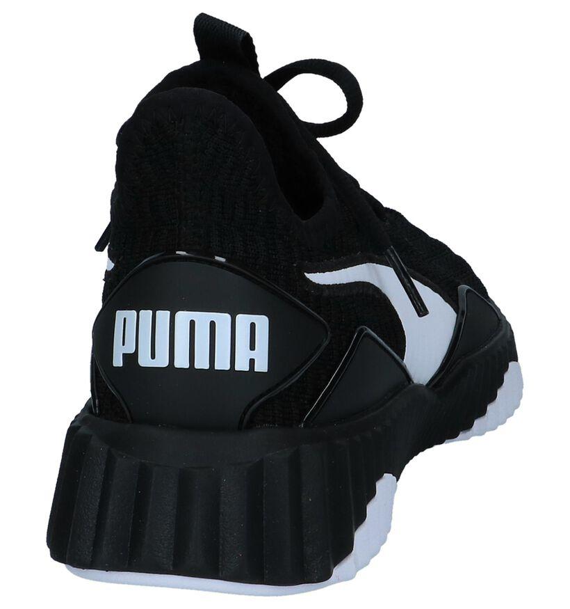 Zwarte Runner Sneakers Puma Defy in stof (239411)